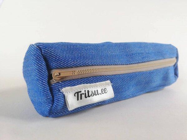 Helesinine kott sinise, punase ja beezi lukuga
