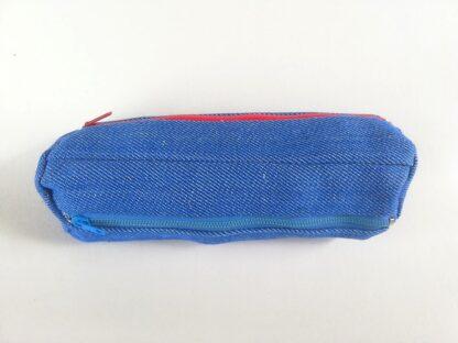Helesinine teksariidest kott sinise, punase ja beezi lukuga