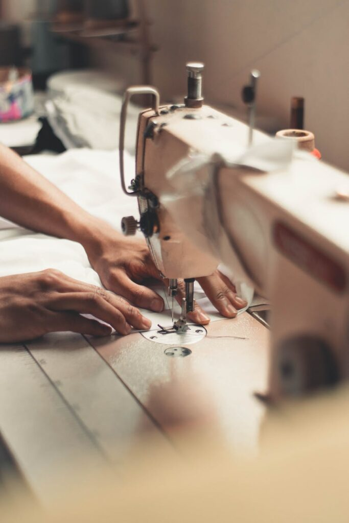 person holding sewing machine